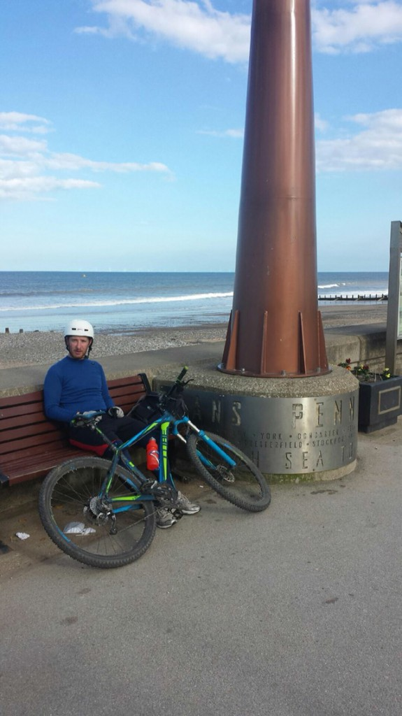 Exhausted but happy - Carl at the finishing post in Hornsea